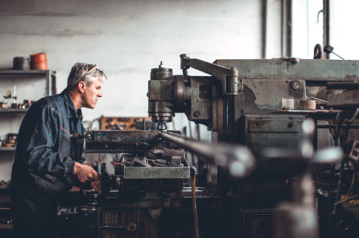 istock Senior man in workshop 638925760