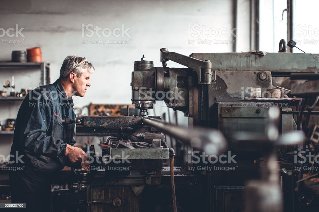 Senior man in workshop stock photo
