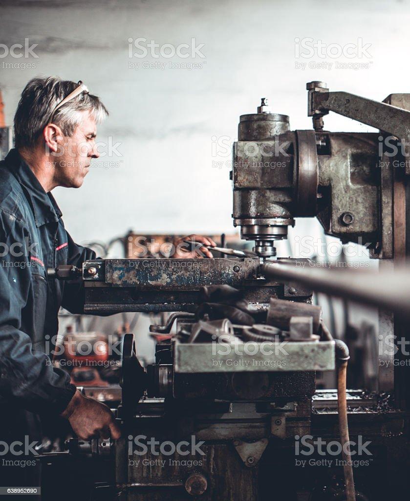 Senior man in workshop stock photo