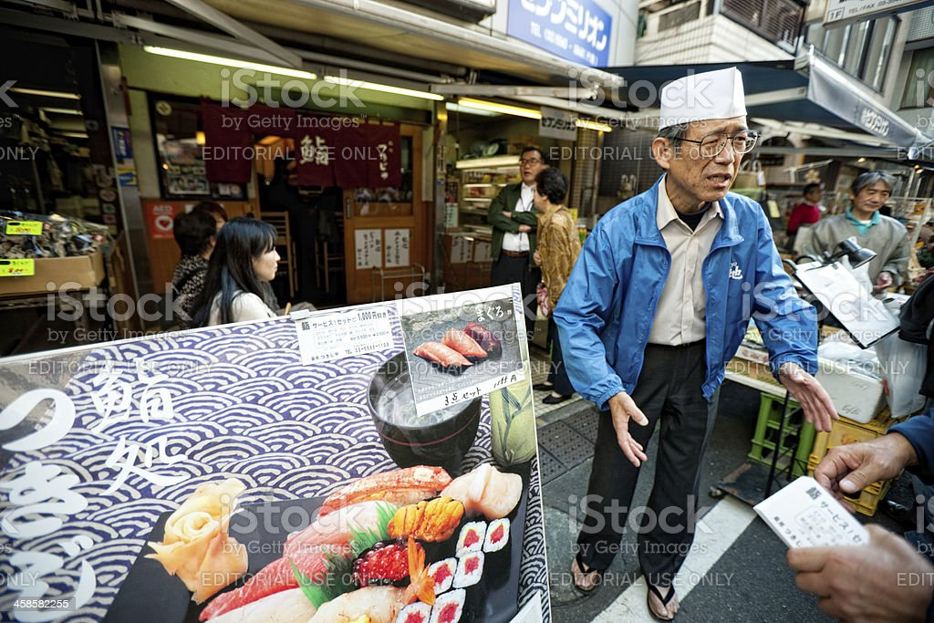 Senior Man inviting people inside his cafe royalty-free stock photo