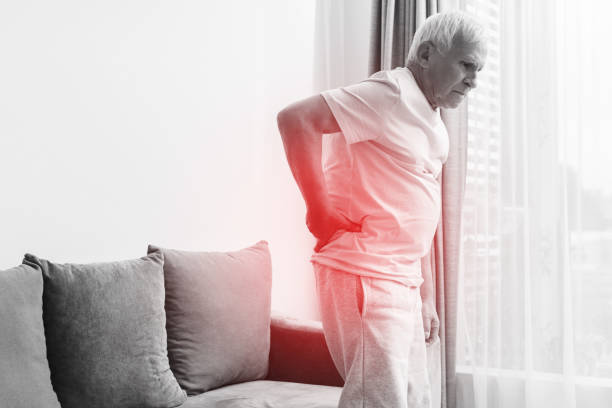 Senior man is suffering from pain in lower back stock photo