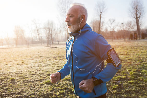 Senior man jogging in the morning Senior man jogging in city 60 64 years stock pictures, royalty-free photos & images