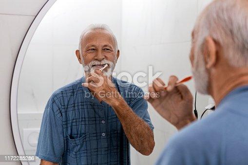 istock Senior man keeping their dental hygiene 1172285286