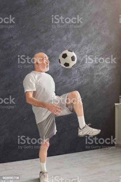 Senior man kicking soccer ball indoors picture id958895706?b=1&k=6&m=958895706&s=612x612&h=ufsnmgso61dqud2omsyxx92pxrq7tuik a5odyoyfeo=