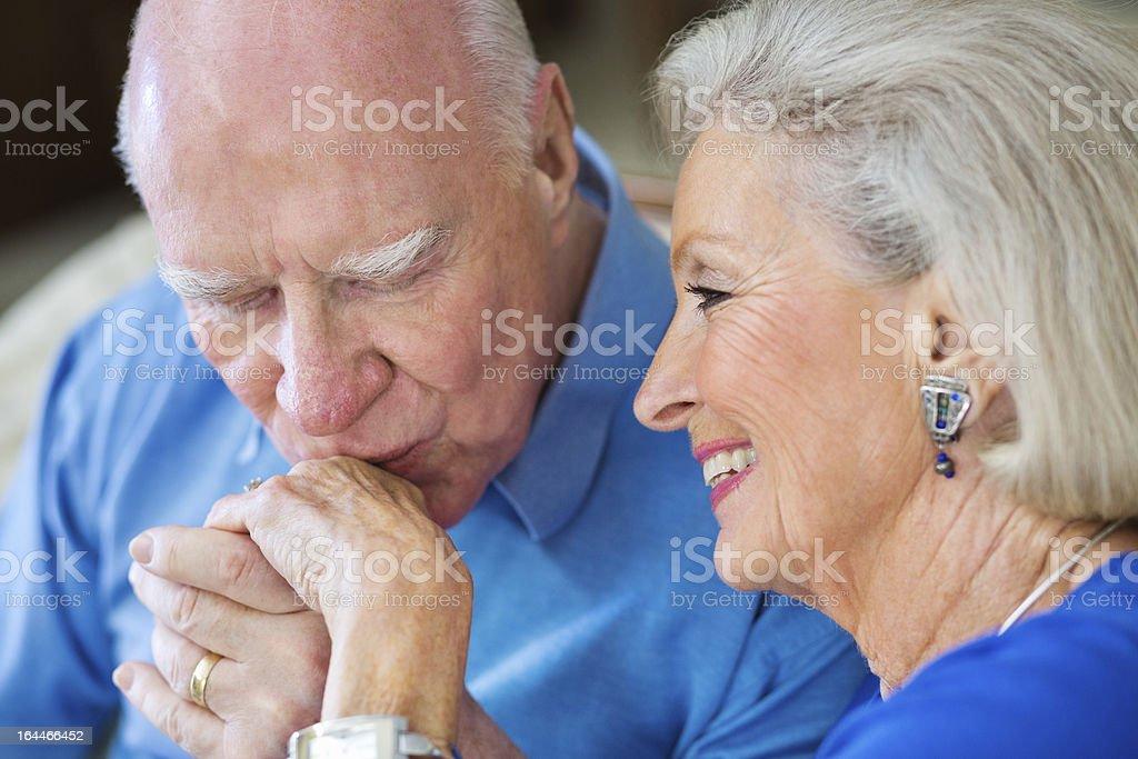 Senior Man Kissing Wife's Hand royalty-free stock photo