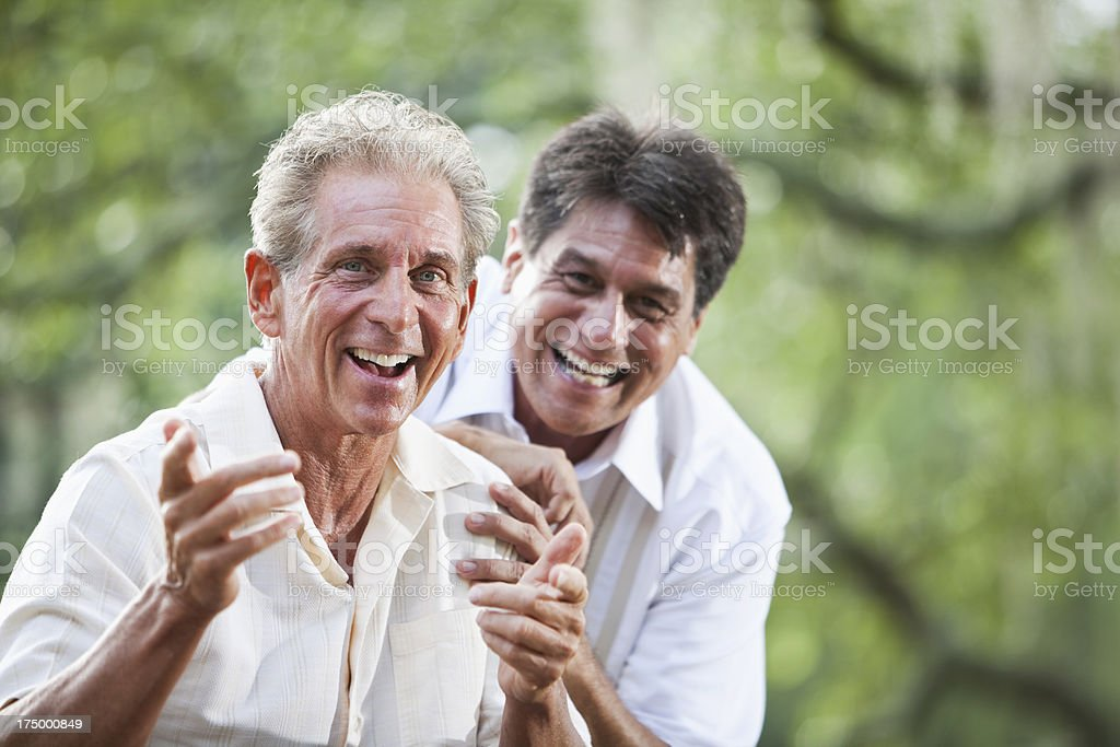 Senior man laughing with friend royalty-free stock photo