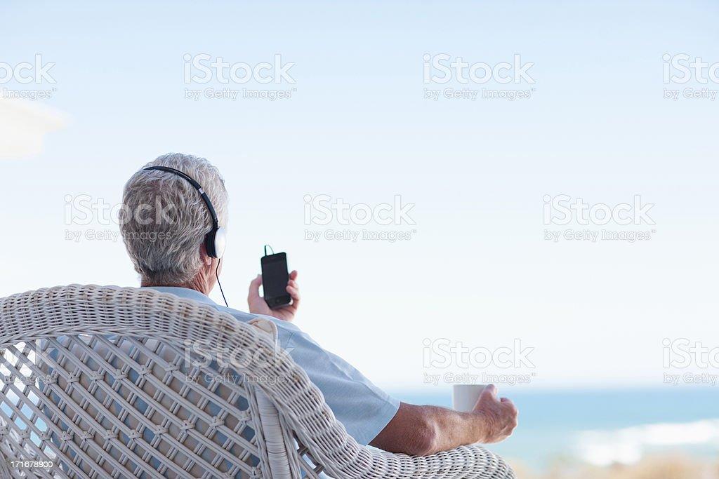 Senior man listening to mp3 player royalty-free stock photo