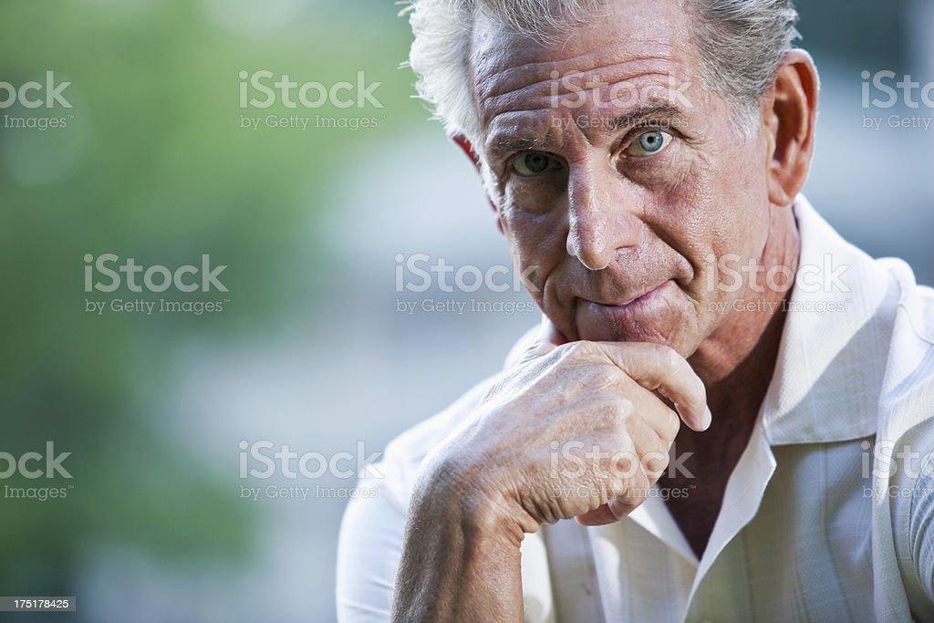Senior man looking at camera stock photo