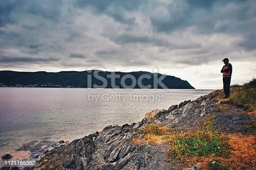 Beautiful landscape seen from the beach with pebbles and seaweed at Bonne Bay , Norris Point, in Gros Morne National Park.