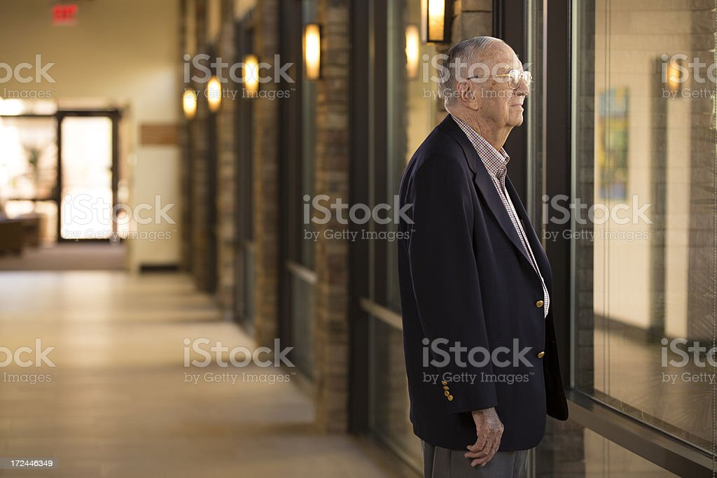 Senior Man looking out the window royalty-free stock photo
