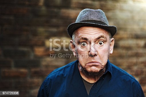 istock Senior man looks shocked 974725338