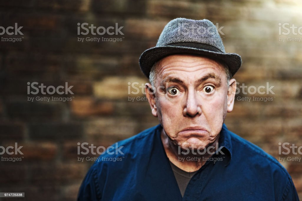 Senior man looks shocked stock photo