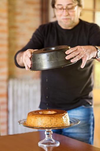Senior man making Dulce de Leche cake