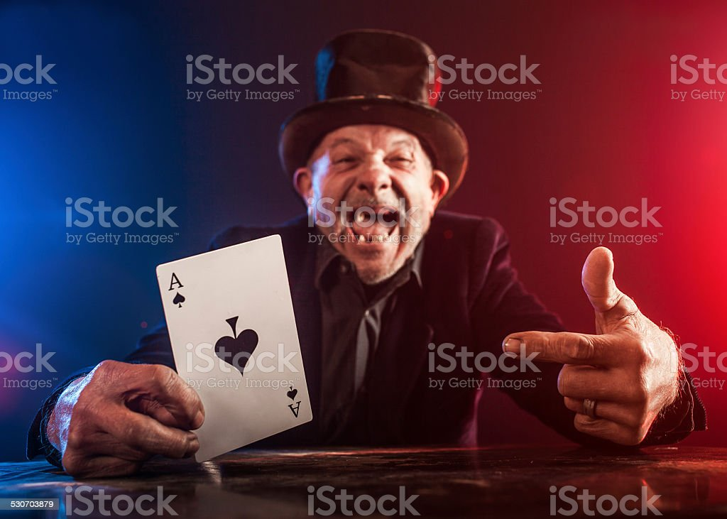 Senior man making trick with playing cards stock photo