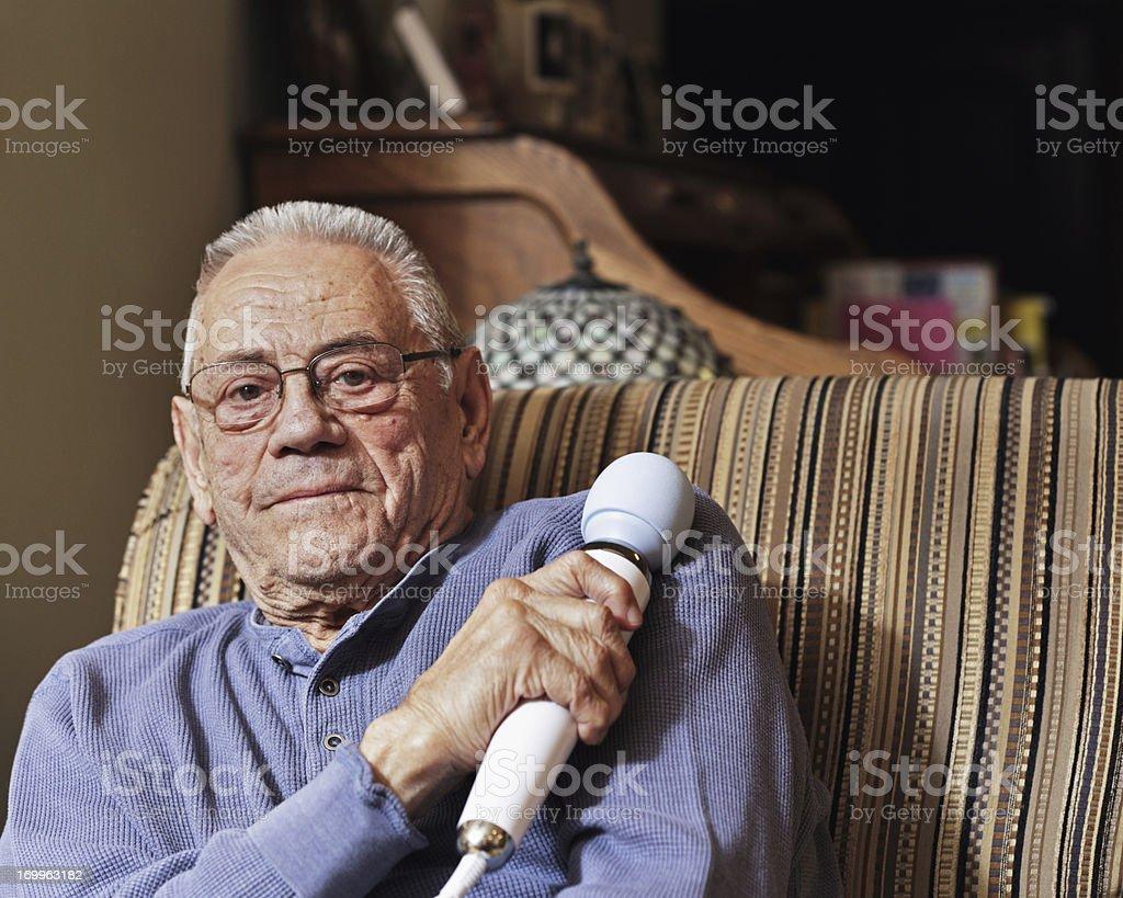 Senior Man Massaging Sore Shoulder stock photo