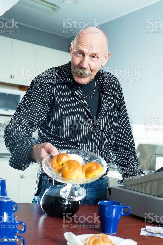 Senior Man Offering Breakfast royalty-free stock photo