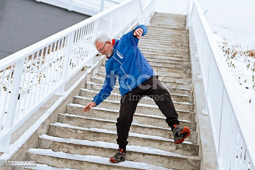 Senior man on a icy staircase