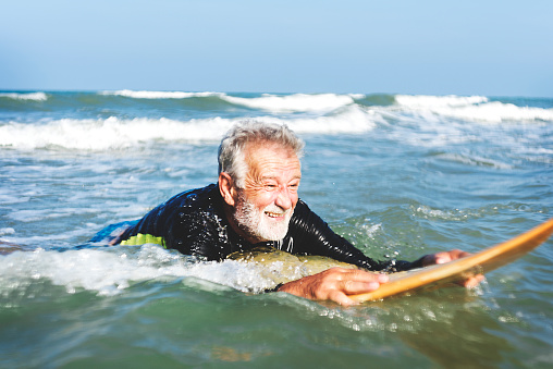 istock A senior man on a surfboard 966178346