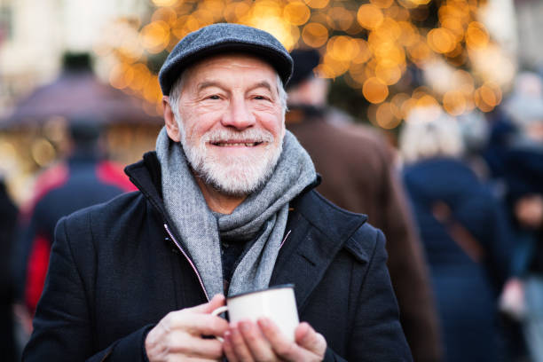 senior man on an outdoor christmas market. - slovacchia foto e immagini stock