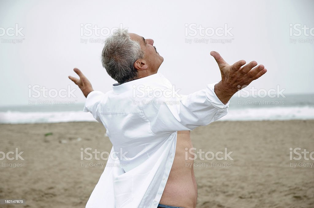 Senior Man on Beach - open arms royalty-free stock photo