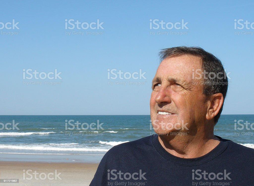 senior man on beach stock photo
