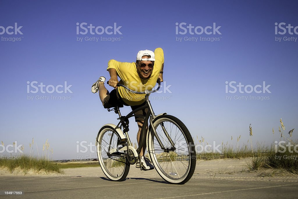 Senior Man on Bicycle Celebrating stock photo