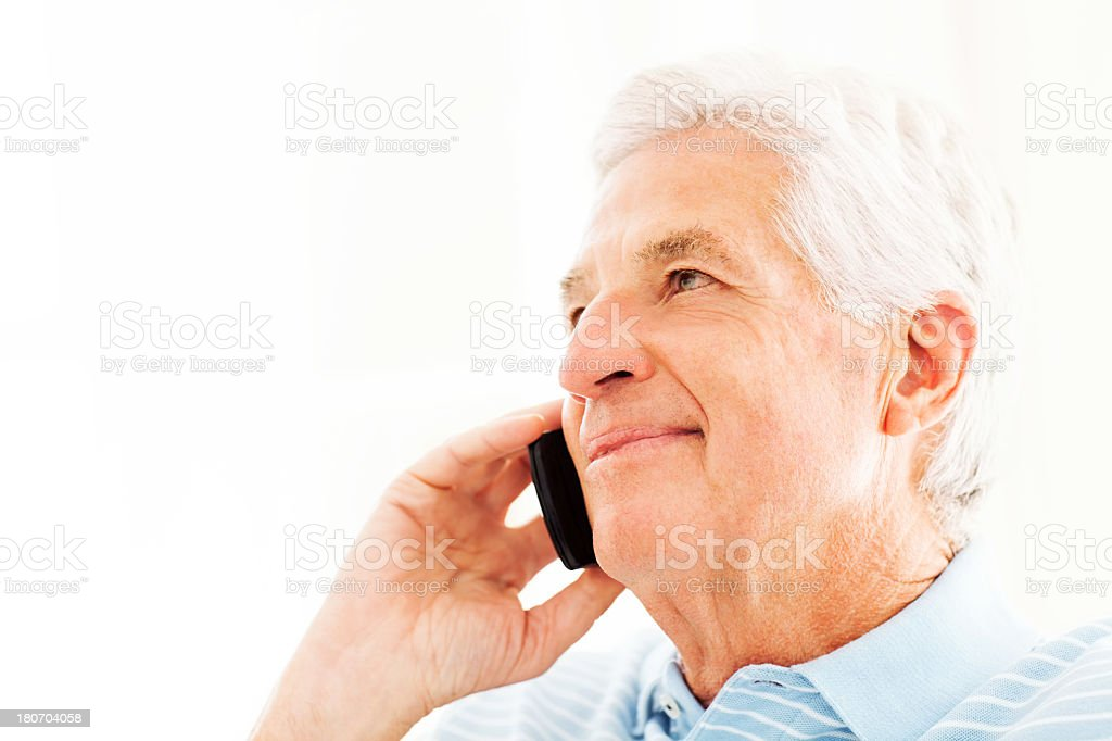 Senior Man On Call While Looking Away royalty-free stock photo