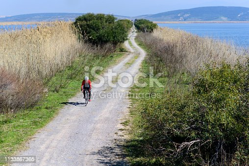 1029243348 istock photo Senior man on his bike 1133867365