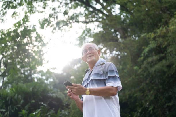 Senior man on his mobile phone stock photo
