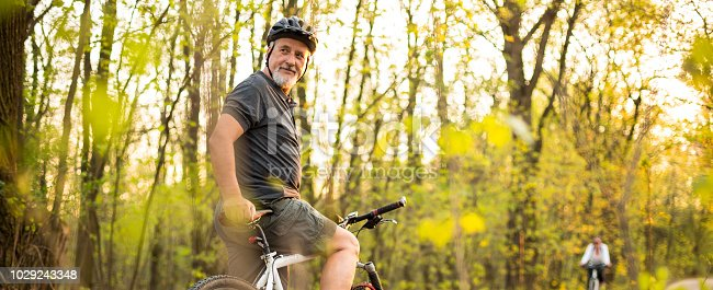 1029243348 istock photo Senior man on his mountain bike outdoors 1029243348