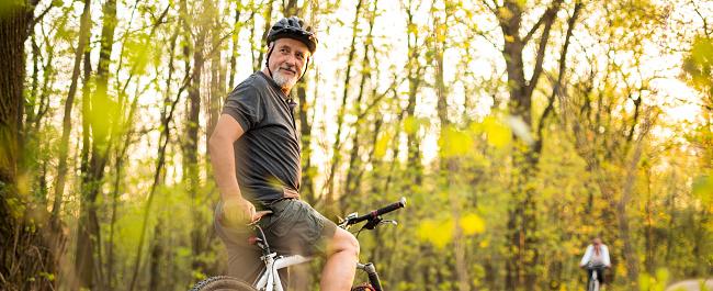istock Senior man on his mountain bike outdoors 1029243348