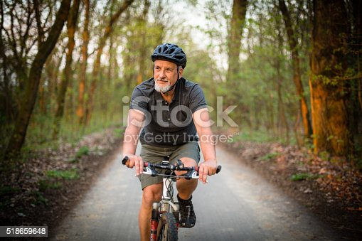 518659854istockphoto Senior man on his mountain bike outdoors 518659648