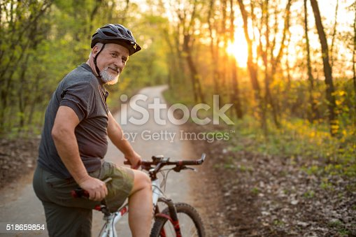 istock Senior man on his mountain bike outdoors 518659854