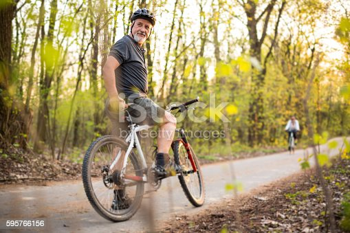 518659854istockphoto Senior man on his mountain bike outdoors 595766156