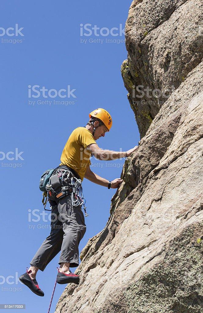 Senior man on steep rock climb in Colorado stock photo