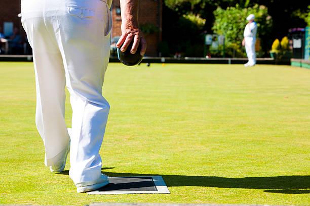 Senior man on the grass bowling green stock photo