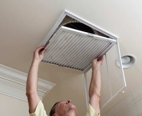 Senior Man Opening Air Conditioning Filter In Ceiling Stock Photo - Download Image Now