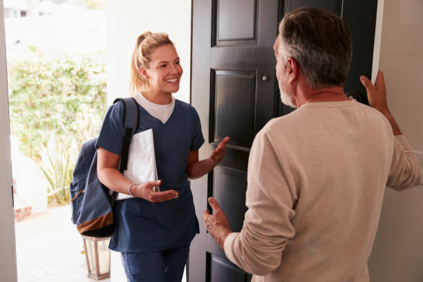 Senior man opening his front door to a female healthcare worker a picture id1094435082?b=1&k=6&m=1094435082&s=612x612&w=0&h=yemeesqktuxfble9j93o1yz 2uhzpecvpayb4p2gnci=
