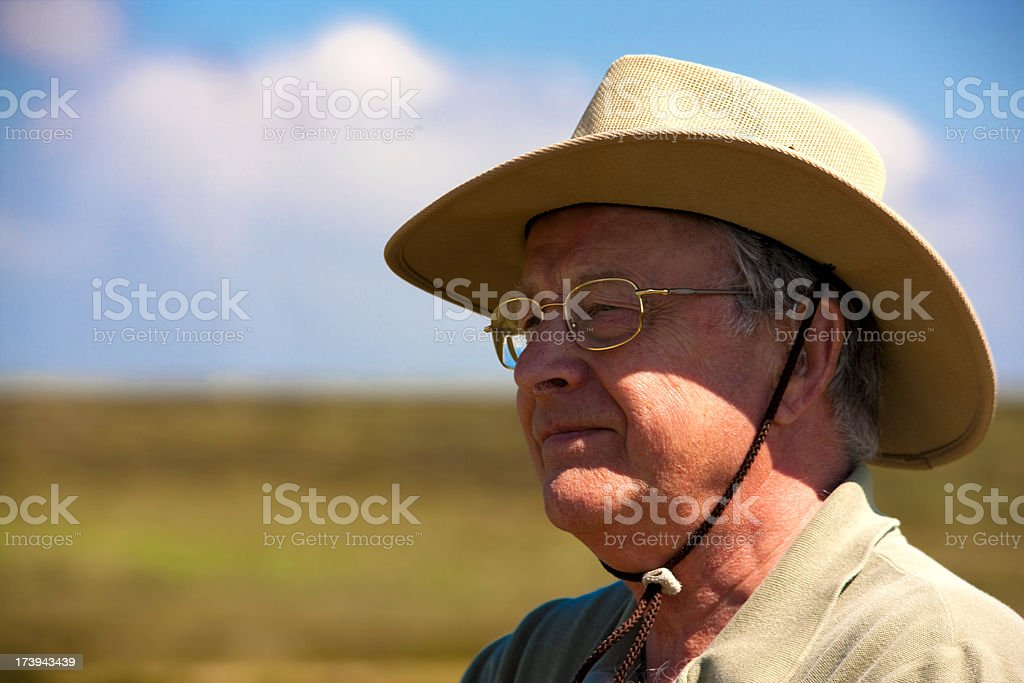 Senior man outdoors with sun hat royalty-free stock photo