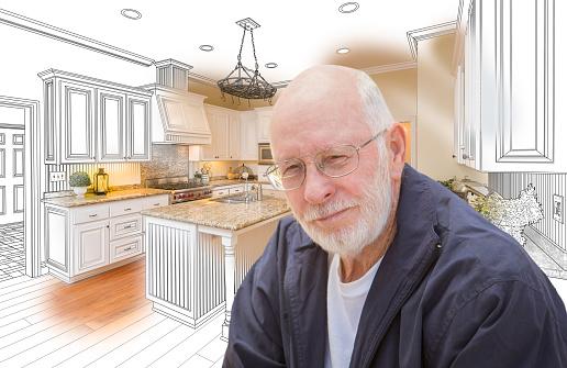 594910248 istock photo Senior Man Over Custom Kitchen Design Drawing and Photo 594910158