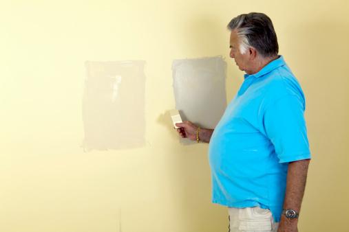 594910248 istock photo senior man paint chip 182850130