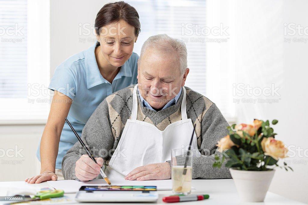 Senior man painting stock photo