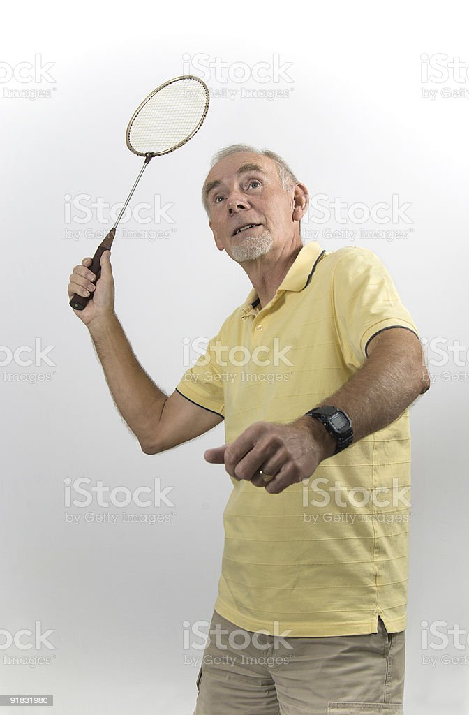 Senior man playing badminton royalty-free stock photo