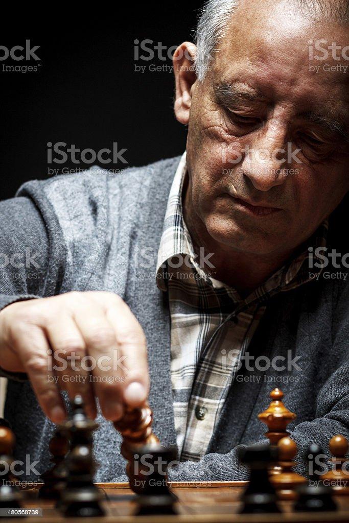 Senior man playing chess royalty-free stock photo