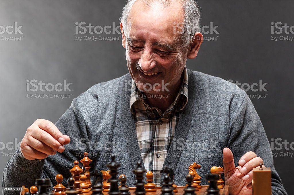 Senior man playing chess royalty-free stock photo
