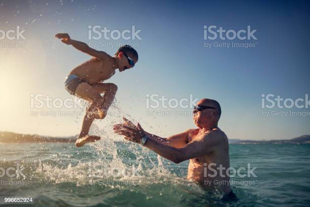 Senior man playing with grandson in sea picture id996652924?b=1&k=6&m=996652924&s=612x612&h=9orqdkibgmwuk59vl 7iutzy0bnd7uwpeooceiq7wye=