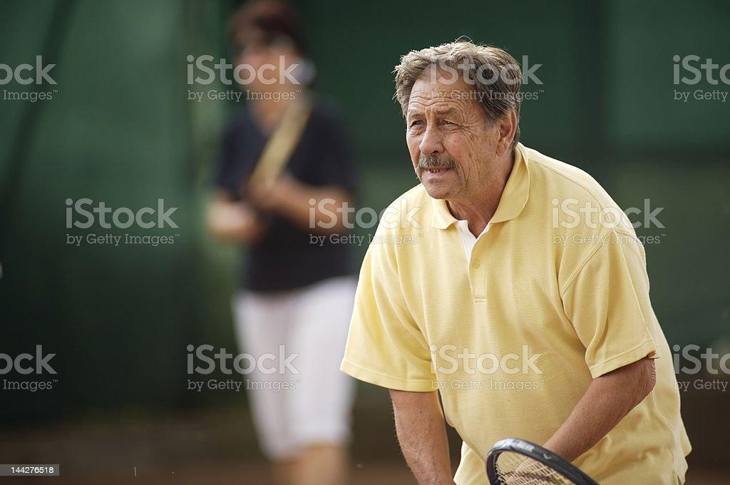 Senior man plays tennis royalty-free stock photo