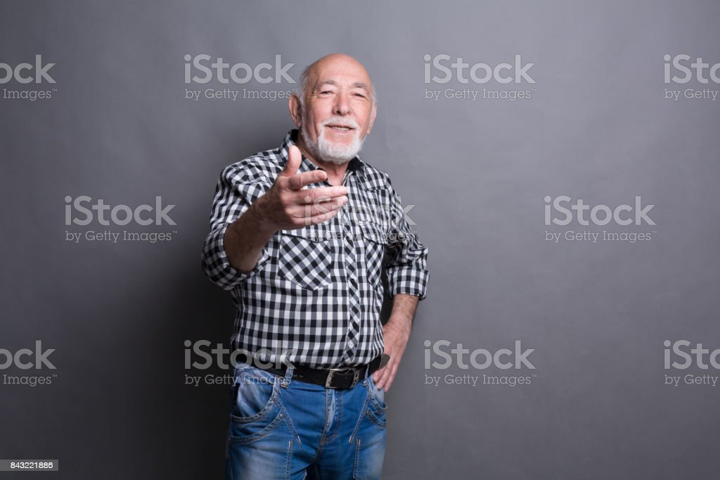 Senior man point gesturing index finger on you stock photo