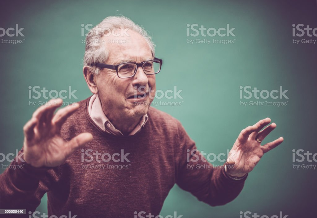 Senior Man Portrait in Standby Position stock photo