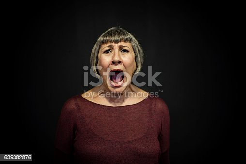 istock Senior Man Portrait on Black Background 639382876